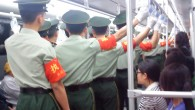 On the 6:44am Line 1 metro out of Shanxi Rd, half the cars are filled with PLA soldiers going to work at People's Square. They occupy the centre aisle, standing in perfect...